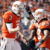 OSU\'s Brandon Weeden celebrates a touchdown with Colton Chelf during the college football game between the Oklahoma State University Cowboys (OSU) and the Baylor University Bears at Boone Pickens Stadium in Stillwater, Okla., Saturday, Nov. 6, 2010. Photo by Sarah Phipps, The Oklahoman