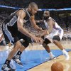 Oklahoma City\'s James Harden (13) defends on San Antonio\'s Tim Duncan (21) during Game 6 of the Western Conference Finals between the Oklahoma City Thunder and the San Antonio Spurs in the NBA playoffs at the Chesapeake Energy Arena in Oklahoma City, Wednesday, June 6, 2012. Photo by Chris Landsberger, The Oklahoman