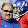 FILE - In this Sept. 26, 2009, file photo, Kansas coach Mark Mangino stands with his team before the start of an NCAA college football game against Southern Miss in Lawrence, Kan. Mangino has resigned two years after leading the Jayhawks to the greatest season in their checkered football history. (AP Photo/Orlin Wagner, File) ORG XMIT: NY184