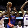 Detroit Pistons\' Brandon Knight (7) tries to drive past Phoenix Suns\' Markieff Morris (11), Shannon Brown (26) and Jermaine O\'Neal (20) in the first half of an NBA basketball game on Friday, Nov. 2, 2012, in Phoenix. (AP Photo/Ross D. Franklin)