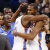 Oklahoma City\'s Kevin Durant (35), right, hugs Serge Ibaka (9) after an NBA basketball game between the Oklahoma City Thunder and the Dallas Mavericks at Chesapeake Energy Arena in Oklahoma City, Thursday, Dec. 29, 2011. Oklahoma City won, 104-102. Photo by Nate Billings, The Oklahoman