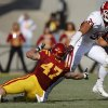 Oklahoma\'s Trey Millard (33) runs past Iowa State\'s A.J. Klein (47) during a college football game between the University of Oklahoma (OU) and Iowa State University (ISU) at Jack Trice Stadium in Ames, Iowa, Saturday, Nov. 3, 2012. Oklahoma won 35-20. Photo by Bryan Terry, The Oklahoman