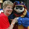 Joan Krauss, Edmond teacher, poses with Marco the Foolish Jester (aka Lisa Hager) of the Looking Glass Players Quality Puppet Theater during Medieval Fair on Friday, March 30, 2012, in Norman, Okla. Photo by Steve Sisney, The Oklahoman