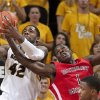 Missouri\'s Alex Oriakhi, left, and Southeast Missouri State\'s Nino Johnson, right, vie for a rebound during the second half of an NCAA college basketball game Tuesday, Dec. 4, 2012, in Columbia, Mo. Missouri won 81-65. (AP Photo/L.G. Patterson)