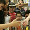 Jessie Guijarro, 7, left, touches slime just before everyone was able to make their own during the