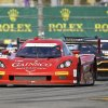 Photo - Alex Gureny, front, passes several cars as he drives the GAINSCO Corvette DP through a horseshoe turn during practice for the IMSA Series Rolex 24 hour auto race at Daytona International Speedway in Daytona Beach, Fla., Thursday, Jan. 23, 2014.(AP Photo/John Raoux)