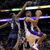 Phoenix Suns\' Jared Dudley, right, drives past Memphis Grizzlies\' Tony Allen (9) during the second half of an NBA basketball game on Wednesday, Dec. 12, 2012, in Phoenix. (AP Photo/Matt York)