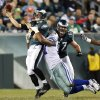 Philadelphia Eagles quarterback Nick Foles, left, is hit by Dallas Cowboys\' Jason Hatcher as he throws in the second half of an NFL football game, Sunday, Nov. 11, 2012, in Philadelphia. (AP Photo/Julio Cortez)