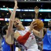 Photo - L.A. CLIPPERS: Oklahoma City Thunder forward Nick Collison, left, and center Nazr Mohammed (8) double team Los Angeles Clippers forward Blake Griffin (32)  in the first half of an NBA basketball game, Monday, April 16, 2012, in Los Angeles. (AP Photo/Gus Ruelas)