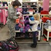USAF Colonel Francesca Bartholomew, helps six year-old Park View Elementary first grader Dakota Leavens pick out a new sweater. More than 35 Department of Defense employees at Tinker Air Force Base teamed with students from various Mid-Del elementary schools Thursday morning, Dec. 5, 2013, on a storewide shopping spree at JC Penney store in Town Center Plaza on SE 29 Street in Midwest City. Photo by Jim Beckel, The Oklahoman