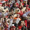 Fans pass mascots Boomer, right, and Sooner, up the stands during the second half of the Bedlam college football game between the University of Oklahoma Sooners (OU) and the Oklahoma State University Cowboys (OSU) at the Gaylord Family-Oklahoma Memorial Stadium on Saturday, Nov. 28, 2009, in Norman, Okla. OU won, 27-0. Photo by Nate Billings, The Oklahoman