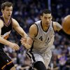 San Antonio Spurs\' Danny Green (4) and Phoenix Suns\' Goran Dragic, of Slovenia, chase the loose ball during the first half of an NBA basketball game, Sunday, Feb. 24, 2013, in Phoenix. (AP Photo/Matt York)