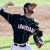 Louisiana-Lafayette pitcher Austin Robichaux delivers in the first inning of an NCAA college baseball tournament regional game against Jackson State in Lafayette, La., Friday, May 30, 2014. (AP Photo/Jonathan Bachman)