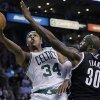Boston Celtics forward Paul Pierce (34) lays up the ball against Brooklyn Nets power forward Reggie Evans (30) during the second quarter of an NBA basketball game in Boston, Wednesday, April 10, 2013. (AP Photo/Elise Amendola)