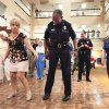 Photo - Rivermont Living Center resident Bonnie Rasmussen shows Norman Police Chief Keith Humphrey how to line dance at last year's National Night Out celebration. PHOTOs BY STEVE SISNEY, THE OKLAHOMAN ARCHIVES