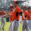 Photo - FILe - In this Feb. 24, 2014 file photo, Baltimore Orioles' Chris Tillman, center, warms up with teammates during the team's baseball spring training workout in Sarasota, Fla., Tillman finally put it all together last season, doubling his win total during a 16-7 year that probably earned him his first opening day start.  (AP Photo/Gene J. Puskar, File)