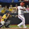 Photo - Louisville's Corey Ray watches as hit hit drops for a single to score two runs in the third inning during an NCAA college baseball regional tournament game in Louisville, Ky., Friday, May 30, 2014. (AP Photo/Timothy D. Easley)