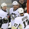 Photo - Pittsburg Penguins' Jarome Iginla (12) celebrates his goal against the Ottawa Senators with Dustin Jeffrey (17) and Brenden Morrow (10) during the first period of their NHL hockey game in Ottawa, Ontario, Monday, April 22, 2013. (AP Photo/The Canadian Press, Fred Chartrand)