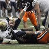 Pittsburgh quarterback Tino Sunseri is sacked by Syracuse\'s Brandon Sharpe during the first quarter of an NCAA college football game in Syracuse, N.Y., Friday, Oct. 5, 2012. (AP Photo/Kevin Rivoli)