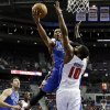 Oklahoma City Thunder guard Russell Westbrook (0) drives on Detroit Pistons center Greg Monroe (10) in the first half of an NBA basketball game in Auburn Hills, Mich., Monday, Nov. 12, 2012. (AP Photo/Paul Sancya) ORG XMIT: MIPS105