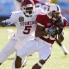 Oklahoma\'s Joseph Ibiloye (5) brings down Stanford\'s Doug Baldwin (89) during the first half of the Brut Sun Bowl college football game between the University of Oklahoma Sooners (OU) and the Stanford University Cardinal on Thursday, Dec. 31, 2009, in El Paso, Tex. Photo by Chris Landsberger, The Oklahoman