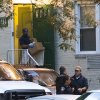 A federal agent removes evidence from the apartment complex where Miriam Carey is believed to have lived in Stamford, Conn., Friday, Oct. 4, 2013. Law-enforcement authorities have identified Carey, 34, as the woman who, with a 1-year-old child in her car, led Secret Service and police on a harrowing chase in Washington from the White House past the Capitol Thursday, attempting to penetrate the security barriers at both national landmarks before she was shot to death, police said. The child survived. (AP Photo/John Minchillo)