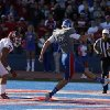 KU\'s Trevor Pardula (16) kicks the ball out of the back of the end zone as OU\'s Matt Dimon (90) and Londell Taylor (31) chase him down after a blocked punt during the college football game between the University of Oklahoma Sooners (OU) and the University of Kansas Jayhawks (KU) at Memorial Stadium in Lawrence, Kan., Saturday, Oct. 19, 2013. Oklahoma won 34-19. Photo by Bryan Terry, The Oklahoman