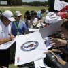 Photo - Fans try for a autograph from Phil Mickelson after a practice round for the U.S. Open golf tournament in Pinehurst, N.C., Tuesday, June 10, 2014. The tournament starts Thursday. (AP Photo/Chuck Burton)