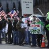 Supporters of both sides of the gun debate gather outside the National Shooting Sports Foundation headquarters in Newtown, Conn., Thursday, March 28, 2013. Search warrants released Thursday, March 28, 2013, revealed that an arsenal of weapons including guns, more than a thousand rounds of ammunition, a bayonet and several swords was seized at Adam Lanza\'s home. Lanza killed his mother, Nancy Lanza in their home before he forced his way into Sandy Hook Elementary School in Newtown, Conn, killing 26 people. (AP Photo/Jessica Hill)