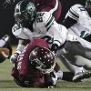 Photo - Norman North's Adim Chukwurah (22) forces a fumble on Jenks' Trey'Vonne Barr'e (5) during the Class 6A Oklahoma state championship football game between Norman North High School and Jenks High School at Boone Pickens Stadium on Friday, Nov. 30, 2012, in Stillwater, Okla. Photo by Chris Landsberger, The Oklahoman