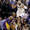 Dallas Mavericks\' Vince Carter (25) leaps at Los Angeles Lakers\' Kobe Bryant, left, in the second half of an NBA basketball game, Sunday, Feb. 24, 2013, in Dallas. Bryant scored 38 points in their 103-99 win. (AP Photo/Tony Gutierrez)
