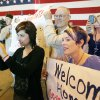 Halsey Musselman (left), Bill Pearsall, and Ashley Musselman watch and cheer as Oklahoma National Guard soldiers return from Afghanistan to a welcome home ceremony in Oklahoma City, OK, Tuesday, March 13, 2012, By Paul Hellstern, The Oklahoman