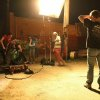 "Producer/director Kyle Roberts, center, works with the crew during a night shoot for the Oklahoma-made coming-of-age superhero movie ""The Posthuman Project"" in Oklahoma City\'s Automobile Alley."