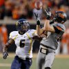 Oklahoma State\'s Austin Hays (84) catches a pass beside West Virginia\'s Pat Miller (6) during a college football game between Oklahoma State University (OSU) and West Virginia University at Boone Pickens Stadium in Stillwater, Okla., Saturday, Nov. 10, 2012. Oklahoma State won 55-34. Photo by Bryan Terry, The Oklahoman