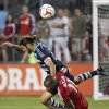 Photo - Toronto FC midfielder Jackson, bottom, battles for the ball against Sporting Kansas City's Graham Zusi, top, during second-half MLS soccer game action in Toronto, Saturday, July 26, 2014. (AP Photo/The Canadian Press, Nathan Denette)