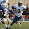 Southmoore\'s Jaelon Walker (3) carries the ball against Enid\'s Alex Lofton (2) during a high school football scrimmage at Moore Stadium in Moore, Okla., Friday, Aug. 17, 2012. Photo by Nate Billings, The Oklahoman