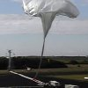 Photo - This image taken from video provided by NASA shows the launch of the high-altitude balloon carrying a saucer-shaped vehicle for NASA, to test technology that could be used to land on Mars, Saturday June 28, 2014 in Kauai, Hawaii. Saturday's experimental flight high in Earth's atmosphere is testing a giant parachute designed to deliver heavier spacecraft and eventually astronauts.  (AP Photo/NASA)