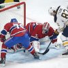 Montreal Canadiens\' goaltender Carey Price makes a save against Buffalo Sabres\' Marcus Foligno (82) as Canadiens\' P.K. Subban moves in during the second period of an NHL hockey game in Montreal, Saturday ,Feb. 2, 2013. (AP Photo/The Canadian Press, Graham Hughes)