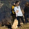 Anne Elizabeth, whose house was spared in a wildfire, hugs Paul Thomas, volunteer firefighter with the Julian/Cuyamaca Fire Protection Service, on Thursday, July 3, 2014, in the Julian, Calif, area. (AP Photo/UT San Diego, Sean M Haffey) MANDATORY CREDIT