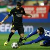 Photo - Atletico goalkeeper Thibaut Courtois, right, dives for a save in front of Barcelona's Neymar during the Champions League quarterfinal second leg soccer match between Atletico Madrid and FC Barcelona in the Vicente Calderon stadium in Madrid, Spain, Wednesday, April 9, 2014. (AP Photo/Paul White)
