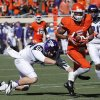 Oklahoma State\'s Josh Stewart (5) runs past TCU\'s James Power (50) for a touchdown on a kick return during a college football game between the Oklahoma State University Cowboys (OSU) and the Texas Christian University Horned Frogs (TCU) at Boone Pickens Stadium in Stillwater, Okla., Saturday, Oct. 19, 2013. Photo by Chris Landsberger, The Oklahoman