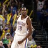 Oklahoma City\'s Kevin Durant (35) celebrates a Thunder score during the NBA basketball game between the Oklahoma City Thunder and the Toronto Raptors at Chesapeake Energy Arena in Oklahoma City, Sunday, April 8, 2012. Photo by Sarah Phipps, The Oklahoman.
