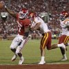 OU\'s DeMarco Murray scores a touchdown in front of Iowa State\'s Zac Sandvig and David Sims during the second half of the college football game between the University of Oklahoma Sooners (OU) and the Iowa State Cyclones (ISU) at the Gaylord Family-Oklahoma Memorial Stadium on Saturday, Oct. 16, 2010, in Norman, Okla. Murray broke the OU school career touchdown record on the play. Photo by Bryan Terry, The Oklahoman