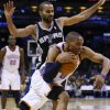 NBA BASKETBALL/NBA/OKLAHOMA CITY THUNDER/SAN ANTONIO SPURS Oklahoma City\'s Russell Westbrook drives past San Antonio\'s Tony Parker during the Thunder - Spurs game Sunday, November 14, 2010 at the Oklahoma City Arena. Photo by Hugh Scott, The Oklahoman ORG XMIT: KOD