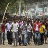 Protestors march down a street demanding the death penalty for those responsible for the collapsed garment factory building, killing hundreds, Tuesday, April 30, 2013 in Savar, near Dhaka, Bangladesh. A top Bangladesh court on Tuesday ordered the government to