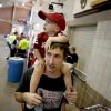23-month old Jax Payne, of Houston, sits on his father Jackson Payne\'s shoulders as they wait in line during the University of Oklahoma\'s Meet the Sooners Day at Gaylord Family-Oklahoma Memorial Stadium in Norman, Okla., Saturday, August 6, 2011. Photo by Bryan Terry, The Oklahoman