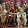 Photo - Texas coach Karen Aston watches the final seconds against Maryland in a second-round game of the NCAA women's college basketball tournament, Tuesday, March 25, 2014, in College Park, Md. Maryland won 69-64. (AP Photo/Gail Burton)