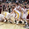 Red Oak celebrates their championship win as Garber\'s Cade Oller (23) walks off the court during the boys Class B State Basketball finals between Red Oak and Garber, Saturday, March 7, 2009, at the State Fair Arena in Oklahoma City . PHOTO BY SARAH PHIPPS, THE OKLAHOMAN