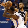 San Antonio\'s Tim Duncan (21) defends Oklahoma City\'s Kendrick Perkins (5) during an NBA basketball game between the Oklahoma City Thunder and the San Antonio Spurs in Oklahoma City Monday, Dec. 17, 2012. Photo by Nate Billings, The Oklahoman