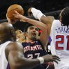 Atlanta Hawks forward Zaza Pachulia (27), of Georgia, battles Los Angeles Clippers center Ronny Turiaf (21), of France, forward Matt Barnes, back center, and Lamar Odom, left, while driving to the basket in the first half of an NBA basketball game on Sunday, Nov. 11, 2012, in Los Angeles. (AP Photo/Gus Ruelas)